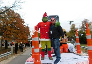 Staff hugs the Grinch at the Christmas Parade