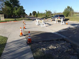 Construction cones and saw horses in roadway